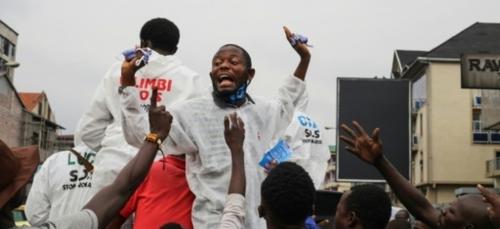 """""""Coronavirus eza te!"""": en RDC, la prévention au défi du déni et des..."""